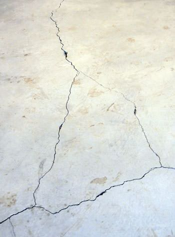 severely cracked, heaving slab floors in a home in Cushing