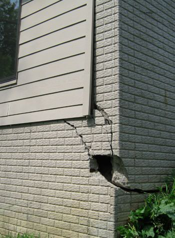 severe cracking of structural walls in Woodward