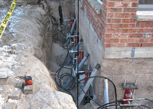 Foundation push piers installed around a house with a foundation settlement issues in Henryetta