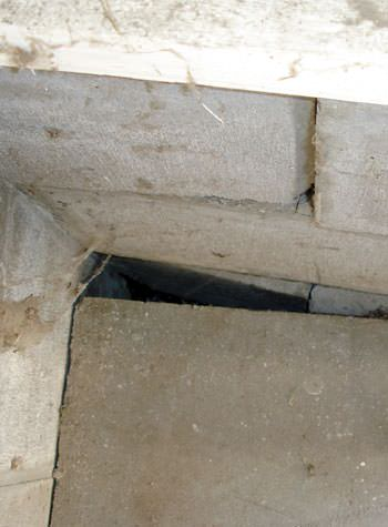 inward rotation of a foundation wall damaged by street creep in a garage in Okmulgee