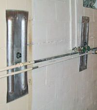 A foundation wall anchor system used to repair a basement wall in Shawnee