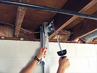 Straightening a foundation wall with the PowerBrace™ i-beam system in a Woodward home.
