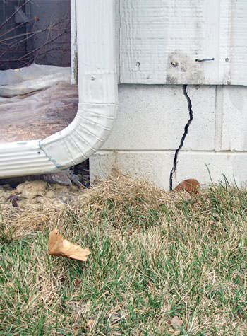 foundation wall cracks due to street creep in Cushing